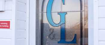g&l windows logo on the door